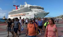 Carnival Sunshine with passengers disembarking