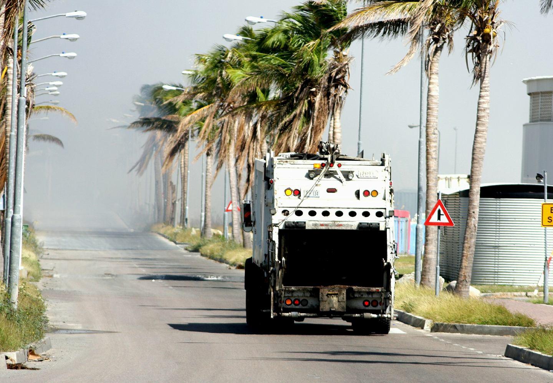 Dump truck heading up Soualiga Boulevard
