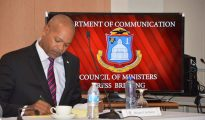 Minister Cornelius de Weever at COM Press Briefing - Photo by Roland Bryson