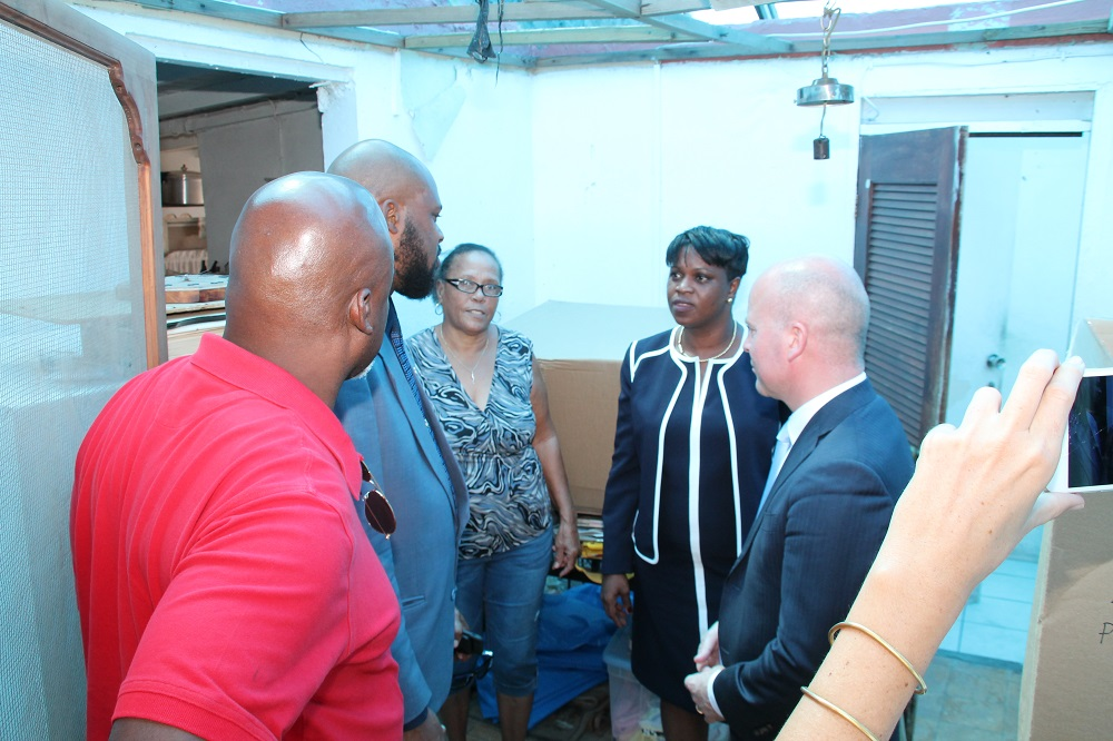PM Leona Marlin - Raymond Knops visit roof repair candidates