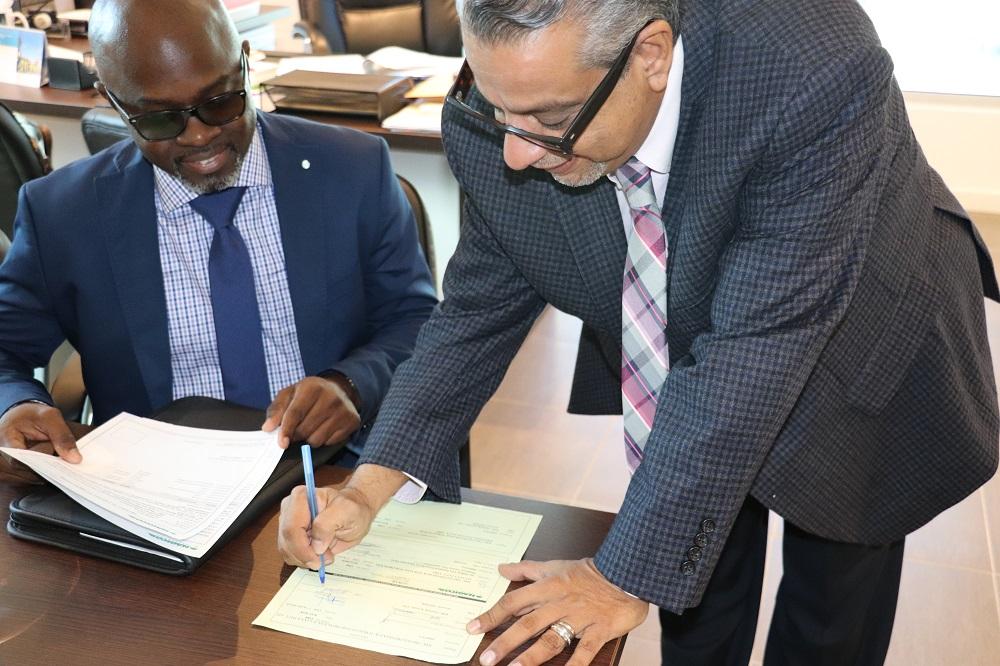 Dwayne Elgin NAGICO - Ravi Daryanani PJIA - check receipt signing