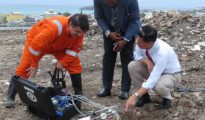 Minister Emil Lee at Dump testing site with VROMI Minister