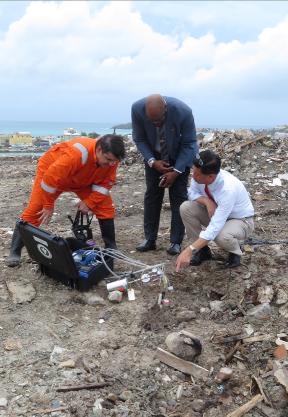 Minister Emil Lee at Dump testing site
