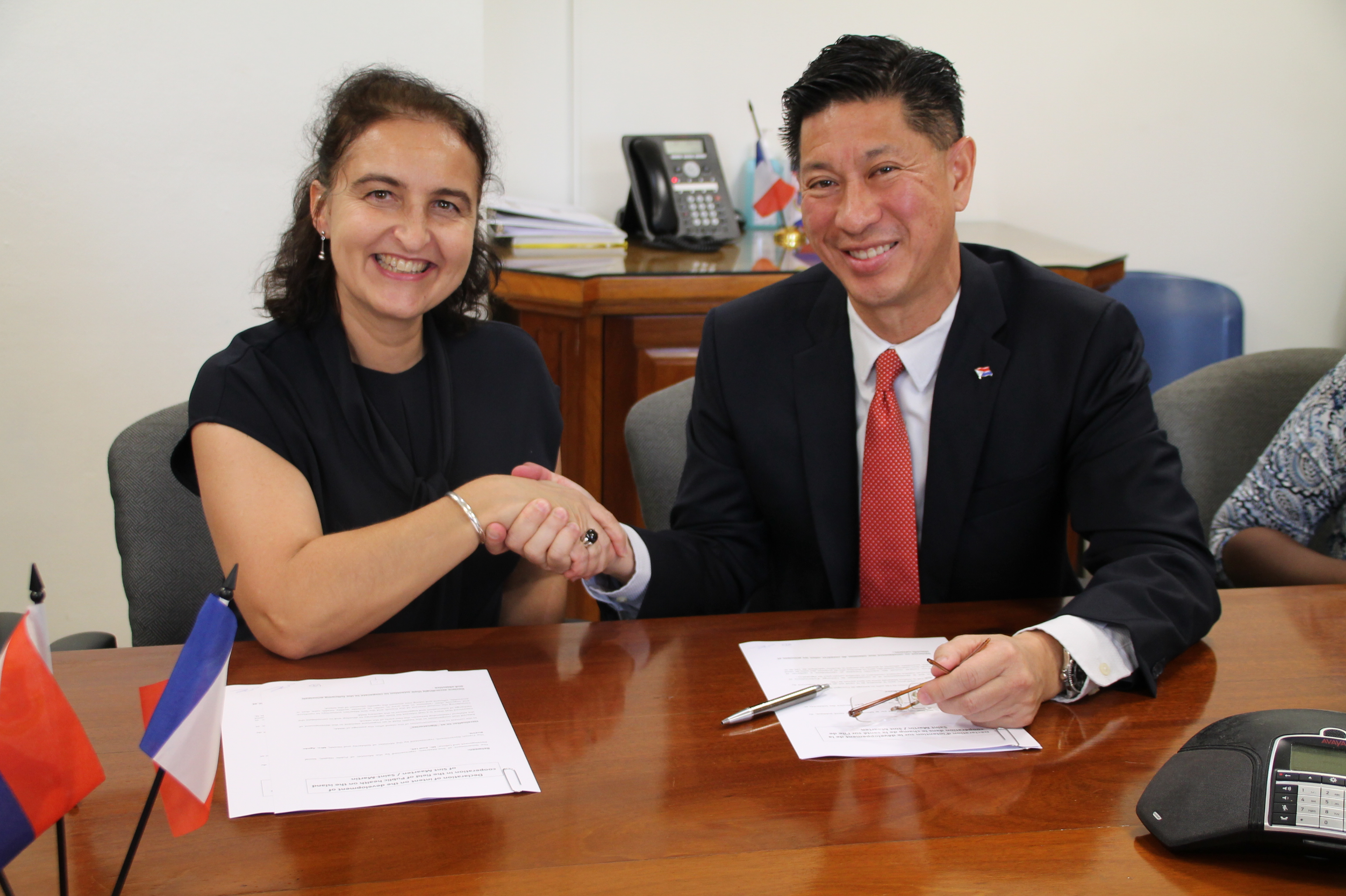Minister Emil Lee signing health cooperation agreement