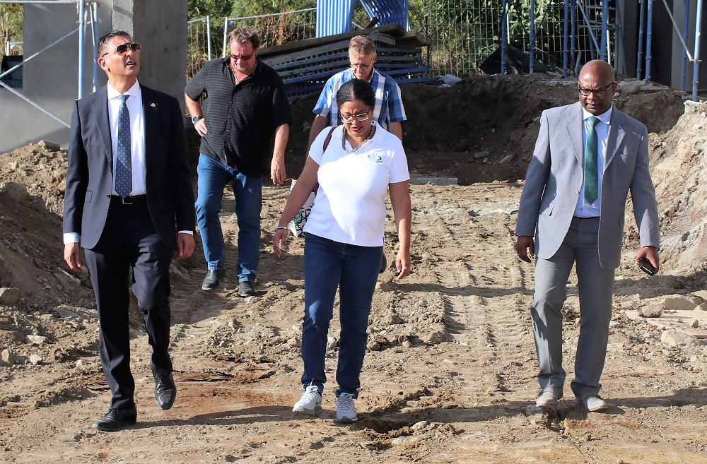 Finance Minister Perry Geerlings tours Oryx Residence in Cay Hill with APS