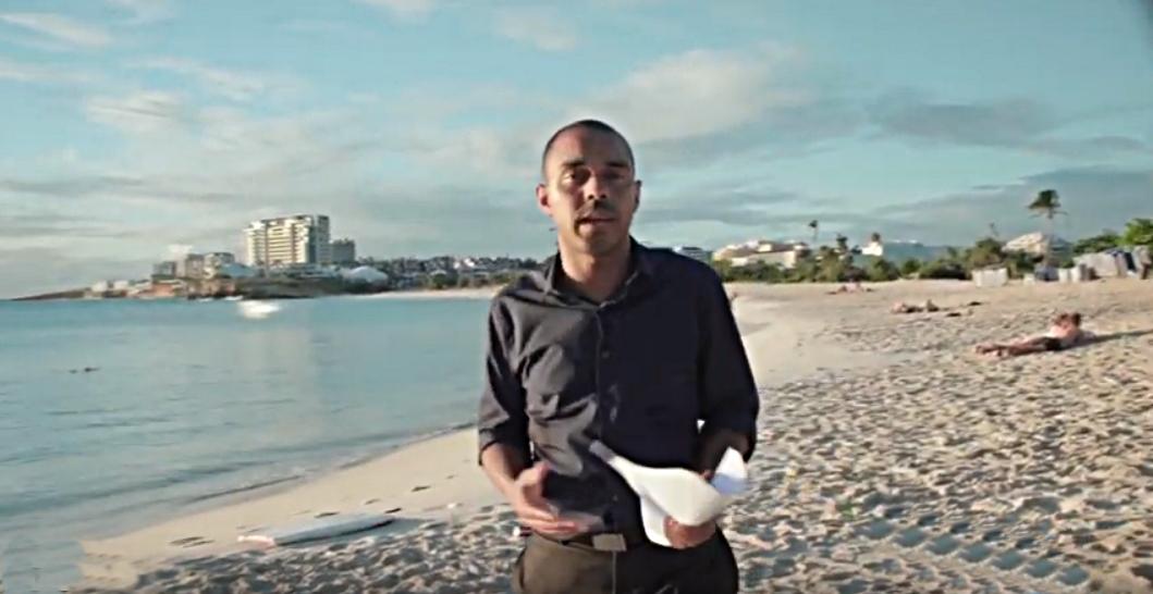 MP Roland Brison on Mullet Bay Beach