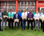 Male staff members at CIBC FirstCaribbean Philipsburg Branch receiving gifts of appreciation for their positive contributions.