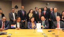 Signing Airport Refinancing Deal in Washington