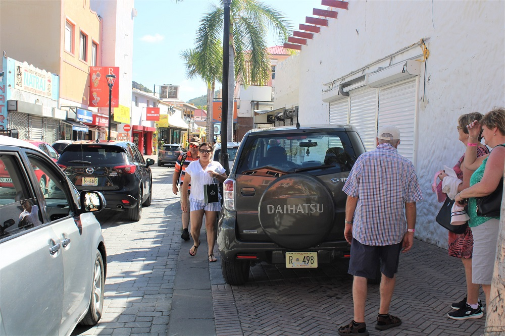 Tourist in town on Front Street filled with cars - 20191128 JH