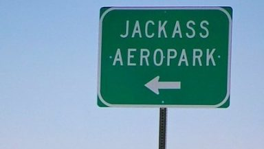 Jackass Airport sign